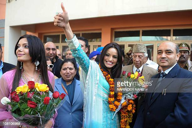 Canadian Member of Parliament Ruby Dhalla with actress Satinder Satti and Principal Neelam Kamra greets students as they arrive at the BBK DAV...
