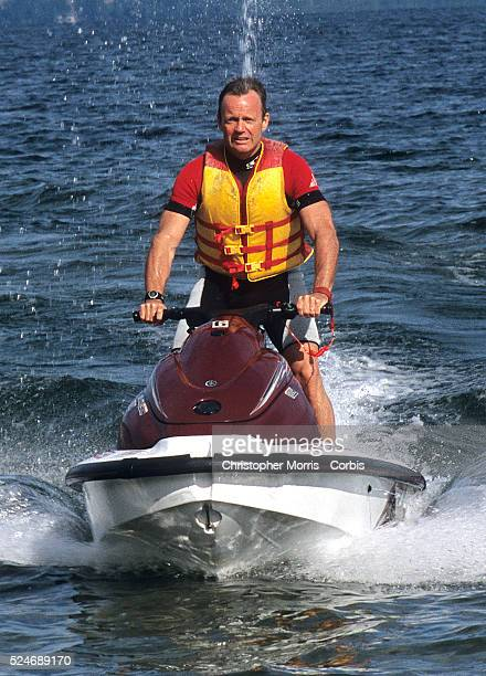 Canadian Member of Parliament, Stockwell Day, arrives at a press conference on a jet ski on Lake Okanagan the day after being elected to the House of...