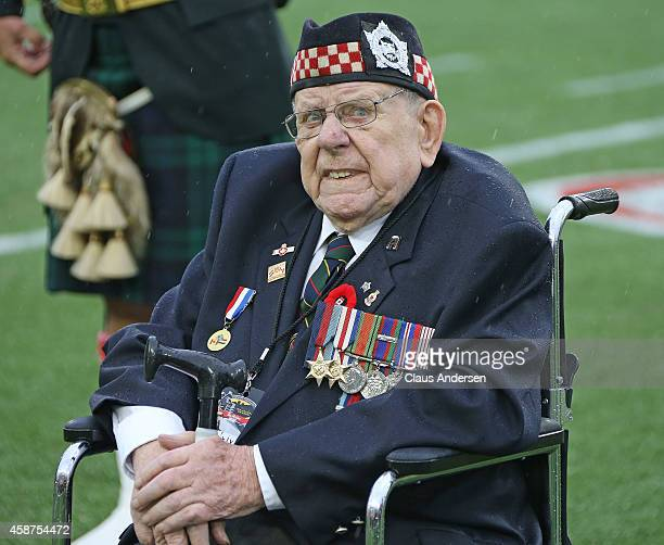 Canadian military veteran waits for the Remembrance Day ceremonies to proceed prior to play between the Montreal Alouettes and the Hamilton TigerCats...