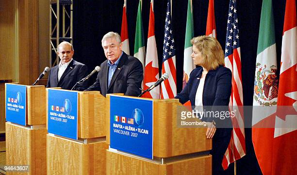 Canadian Minister for International Trade David Emerson, center, speaks during a news conference in Vancouver, Canada, Tuesday, Aug. 14, 2007 as...