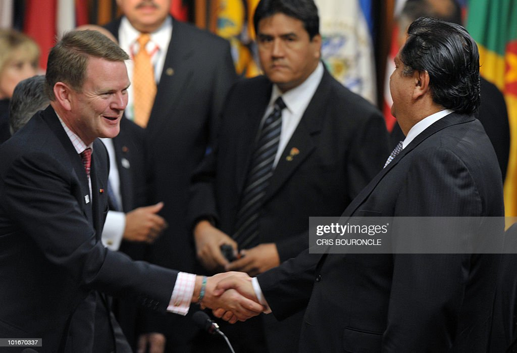 Canadian Minister of Foreign Affairs Peter Kent (L) shakes hands with Peruvian President Alan Garcia (R) before the opening session of the 40th Organization of American States (OAS) General Assembly held in Lima on June 6, 2010. Foreign affairs ministers of the 33 member countries shall meet for three days under the topic 'Peace, Security and Cooperation of the Americas'.
