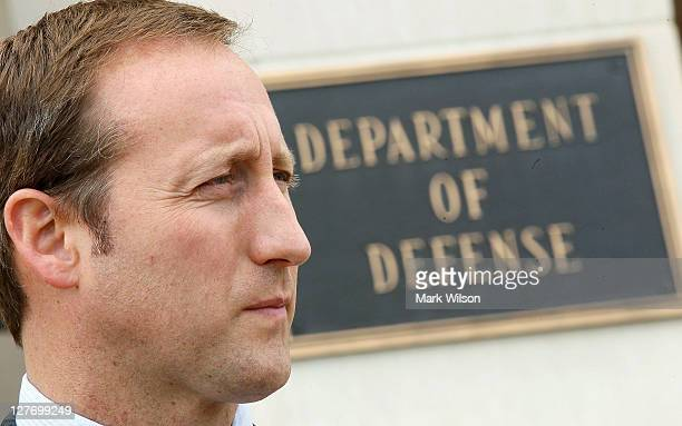 Canadian Minister of National Defence Peter MacKay listens to Secretary of Defense Leon E Panetta speak to the media at the Pentagon on September 30...