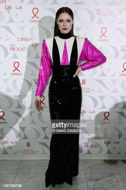 Canadian model Coco Rocha poses during a photocall upon arriving to attend the Diner de la Mode fundraiser dinner to benefit French antiAIDS...