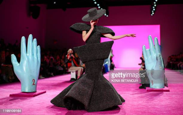 Canadian model Coco Rocha presents a creation for Christian Siriano during New York Fashion Week at Spring Studios on February 6, 2020 in New York...