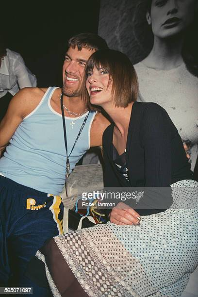 Canadian model Linda Evangelista and American makeup artist and photographer Kevyn Aucoin attend the 1997 Todd Oldham Fall fashion show 1997