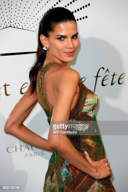 Canadian model Raika Tavares poses during a photocall as part of an event organised by French jeweller Chaumet on July 2 2017 in Paris / AFP PHOTO /...