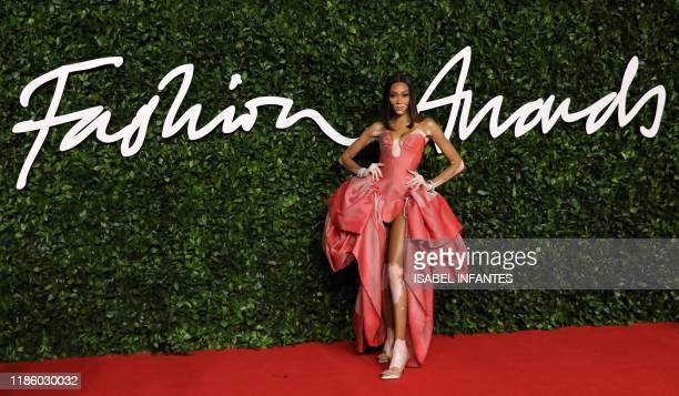 Canadian model Winnie Harlow poses on the red carpet upon arrival at The Fashion Awards 2019 in London on December 2 2019 The Fashion Awards are an...