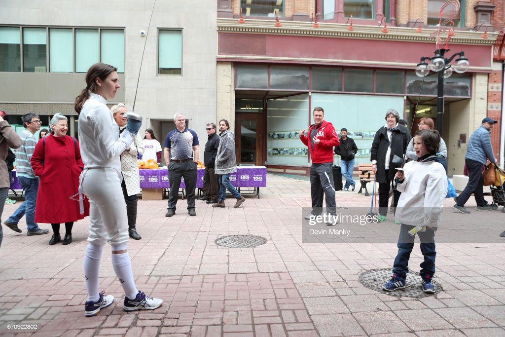 Canadian Modern-Pentathlon Olympian Melanie McCann salutes n young opponent during an outdoor fencing demonstration on Sparks Street during the Medley on the Street event on April 20, 2017 in Ottawa, Canada. The Medley on the Street event promotes Fencing Week in Canada and the upcoming National Canadian Fencing Championships.