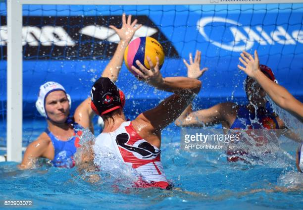Canadian Monika Eggens scores a goal against Russia in 'Hajos Alfred' swimming pool of Budapest on July 28 2017 during the woman bronze match of...
