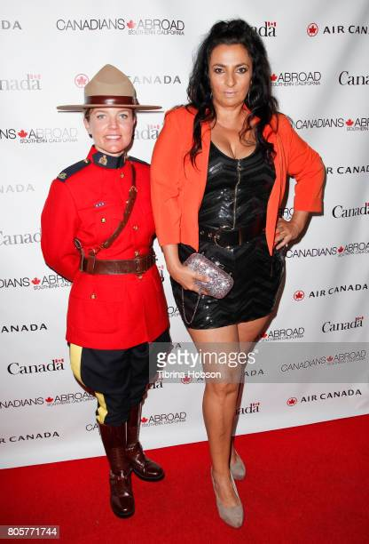 Canadian Mountie and Alice Amter attend the 2017 Canada Day Celebration at Hard Rock Cafe Hollywood on July 1 2017 in Hollywood California