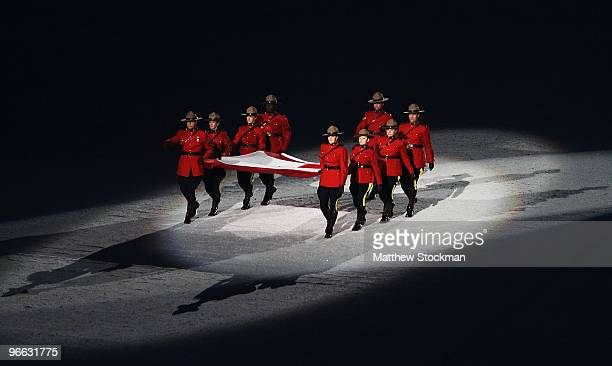 Canadian Mounties carry in the Canadian flag during the Opening Ceremony of the 2010 Vancouver Winter Olympics at BC Place on February 12, 2010 in...