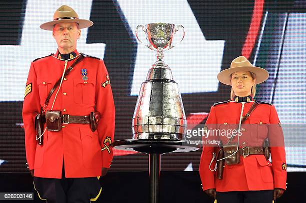 Canadian Mounties guard the Grey Cup following the final whistle of the 104th Grey Cup Championship Game between the Ottawa Redblacks and the Calgary...