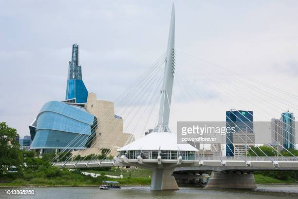 canadian museum of human rights and esplanade riel bridge in winnipeg, manitoba, canada - winnipeg stock pictures, royalty-free photos & images
