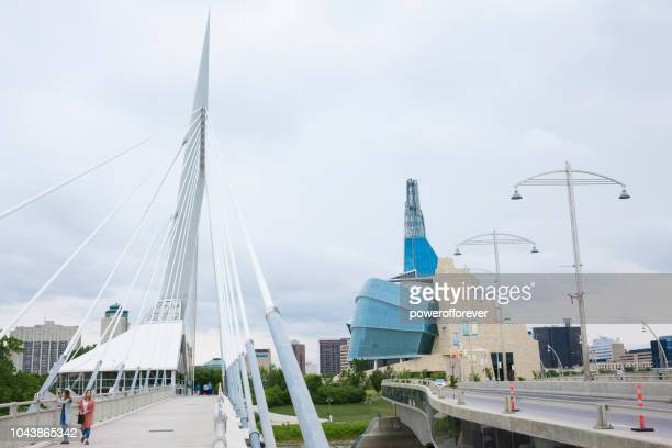 canadian museum of human rights and esplanade riel bridge in winnipeg, manitoba, canada - esplanade riel stock photos and pictures