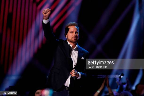 Canadian Music Hall of Fame recipient Corey Hart celebrates during the Juno Music Awards at Budweiser Gardens in London Ontario Canada on March 17...