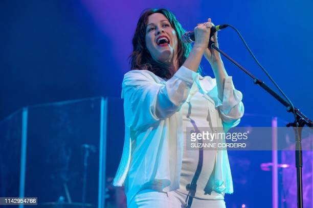 Canadian musician Alanis Morissette performs on stage with her band during Kaaboo Texas music festival at the AT&T Stadium in Arlington, Texas on May...