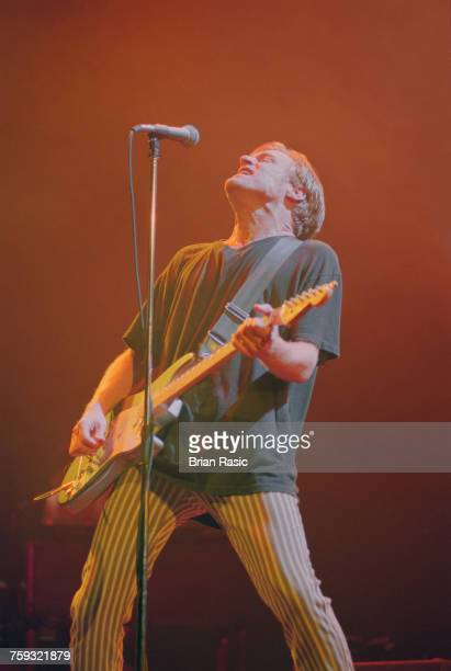 Canadian musician and guitarist Bryan Adams performs live on stage at Wembley Arena in London on 6th May 1994
