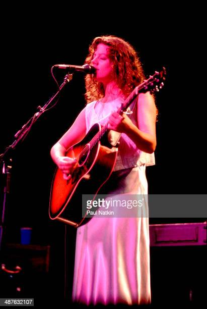 Canadian musician Sarah McLachlan plays guitar as she performs onstage Chicago Illinois August 3 1995