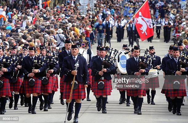 Canadian musicians of the 'Toronto Police Pipe Band' parade playing bagpipes on August 2 2009 in Lorient western France during the celtics nations...