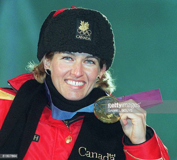 Canadian Myriam Bedard smiles as she displays her gold medal won in the women's 15km individual biathlon at the Winter Olympic Games 18 February 1994...