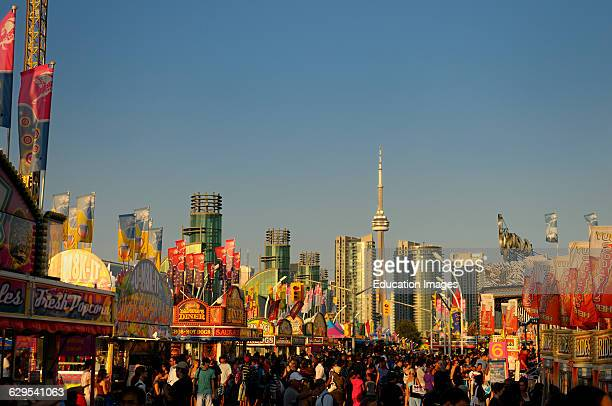 Canadian National Exhibition along the midway at sundown with Toronto skyline