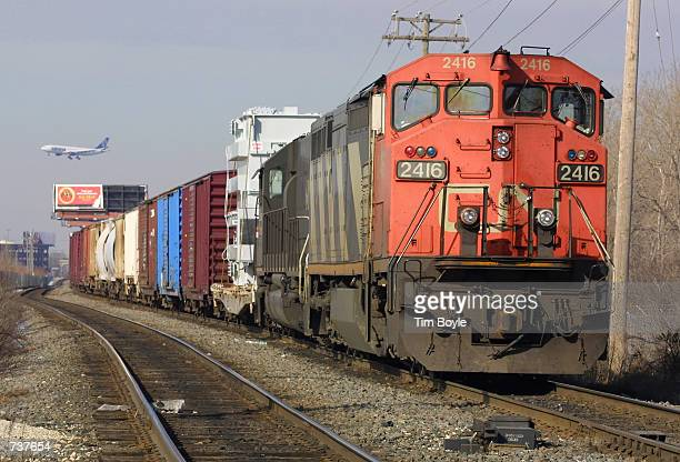 Canadian National freight train idles on Wisconsin Central railroad tracks near Rosemont IL as it waits February 1 2001 for an approach signal...