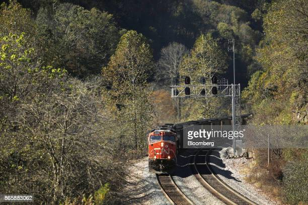 A Canadian National Railway Co locomotive leads a Norfolk Southern Corp coal train through a cut in Superior West Virginia US on Thursday Oct 19 2017...