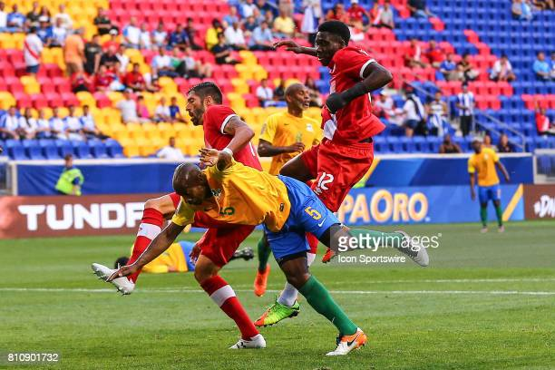 Canadian National Soccer Team midfielder Alphonso Davies battles French Guiana midfielder Cedric Fabien during the first half of the CONCACAF Gold...