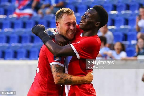 Canadian National Soccer Team midfielder Alphonso Davies celebrates with Canadian National Soccer Team midfielder Scott Arfield during the first half...