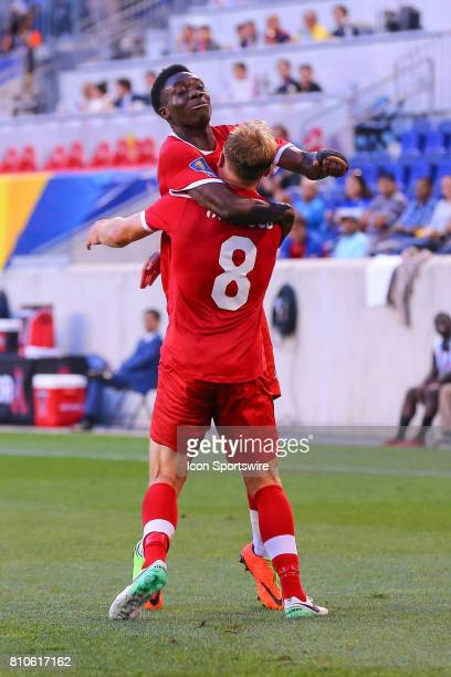 Canadian National Soccer Team midfielder Scott Arfield celebrates with teammate Canadian National Soccer Team midfielder Alphonso Davies after...