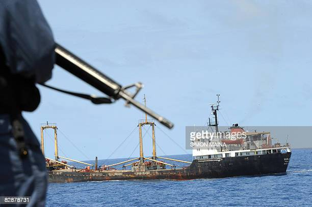 Canadian Navy sailor stays alert while guarding World Food Programme ship into Mogadishu as they provide on September 18 2008 an antipirate escort...