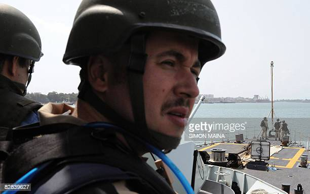 Canadian Navy troops stand guard on the Ville de Quebec warship as they leave Kenya's Mombasa port on September 16 providing an antipirate escort for...
