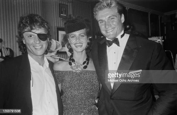 Canadian nightclub owner Peter Gatien with model Paula Barbieri and Swedish actor Dolph Lundgren in New York City, USA, circa 1987.
