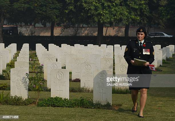 A Canadian officer walks at Delhi War Cemetery in New Delhi on November 9 during a Remembrance Sunday Ceremony Queen Elizabeth was on November 9 set...