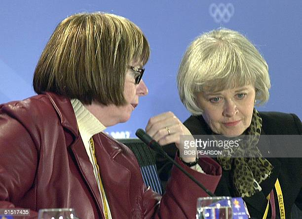 Canadian Olympic Association Chef de Mission Sally Rehorick and Skate Canada President Marilyn Chidlow speak to each other while Michael Chambers...