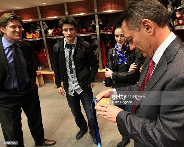 Canadian Olympic Gold Medalist in Ice Dancing Scott Moir and Tessa Virtue stop by the locker room and visit with Head Coach Mike Babcock and...
