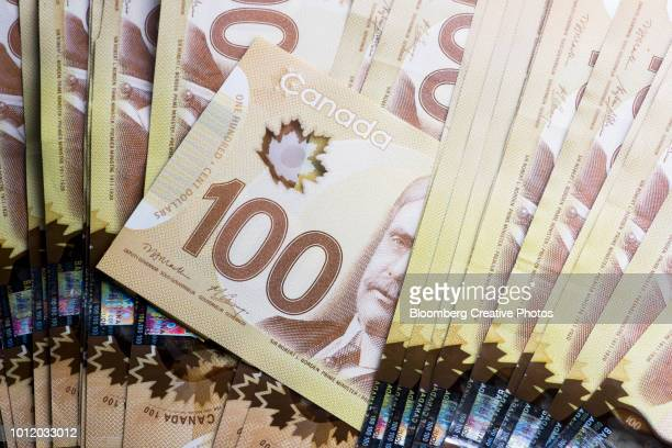 canadian one hundred dollar banknotes - canadian currency stock pictures, royalty-free photos & images