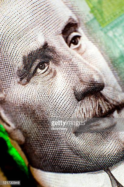 A Canadian onehundred dollar bill is arranged for a photograph in Toronto Ontario Canada on Thursday Aug 18 2011 The Canadian dollar advanced against...