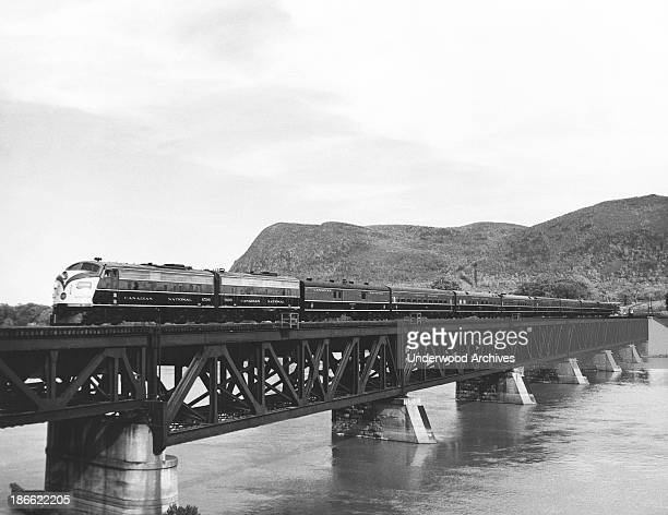 Canadian Pacific passenger train crossing a trestle over a river, Canada, late 1940s.