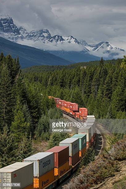 Canadian Pacific Railway freight train makes its way westward along the Bow River on April 23 2016 at Lake Louise Alberta Canada Banff is Canada's...