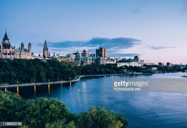canadian parliament on ottawa river (dusk) - london ontario stock pictures, royalty-free photos & images