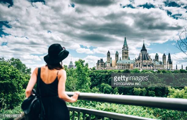 canadian parliament on ottawa river - ottawa stock pictures, royalty-free photos & images