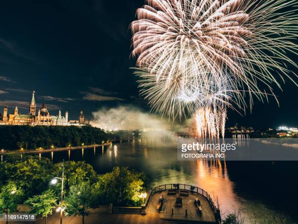 canadian parliament on ottawa river with fireworks - london ontario stock pictures, royalty-free photos & images