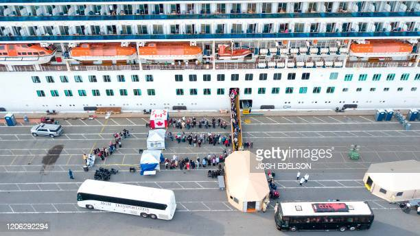 Canadian passengers are disembarked from the Grand Princess cruise ship at the Port of Oakland in California on March 9 2020 The cruise ship carrying...
