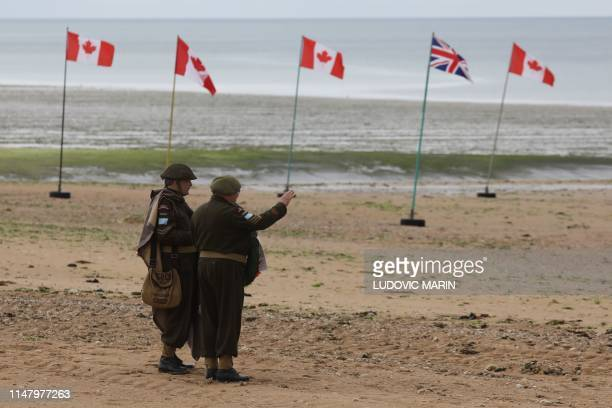 Canadian people dressed as WWII Canadian soldiers visit Juno beach where Canadian soldiers landed on D-day, on June 4 in Bernieres-sur-Mer.