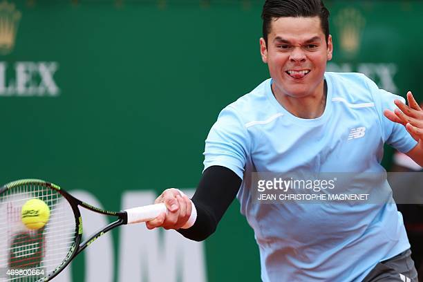 Canadian player Milos Raonic hits a return to Portuguese Joao Sousa during their MonteCarlo ATP Masters Series Tournament tennis match on April 15...