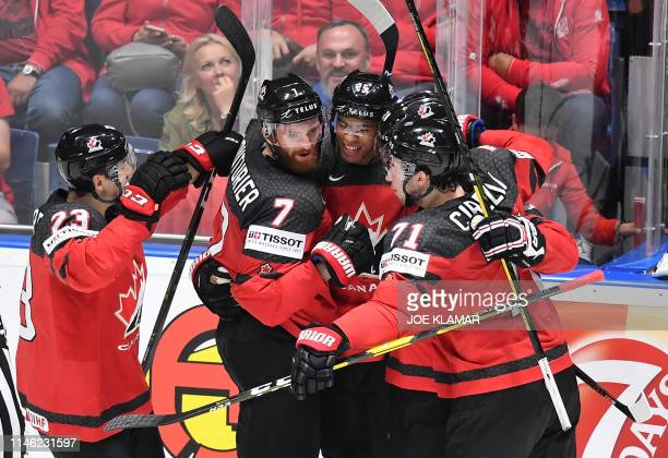 Canadian players celebrate after scoring during the IIHF Men's Ice Hockey World Championships semifinal match between Canada and Czech Republic on...