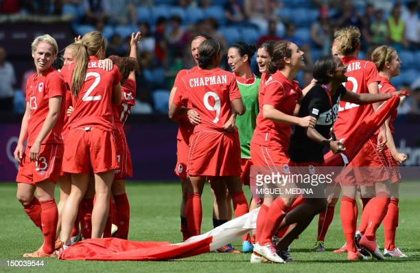 Canadian players celebrate after their team's victory in their women's bronze medal football match between Canada and France at The City of Coventry...
