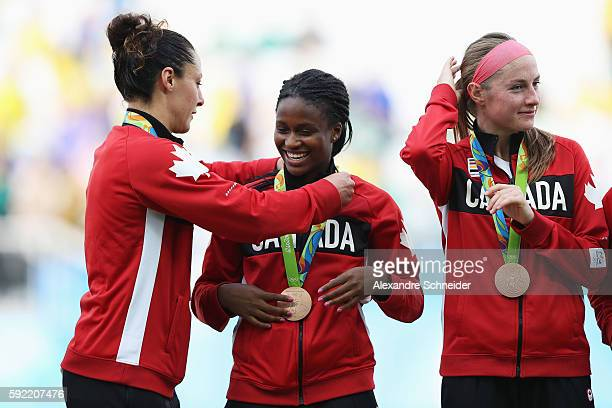 Canadian players celebrate with their medals following their teams victory during the Women's Olympic Football Bronze Medal match between Brazil and...