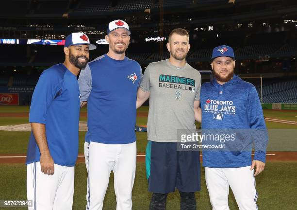 Canadian players Dalton Pompey of the Toronto Blue Jays and John Axford and Russell Martin pose with James Paxton of the Seattle Mariners a couple of...
